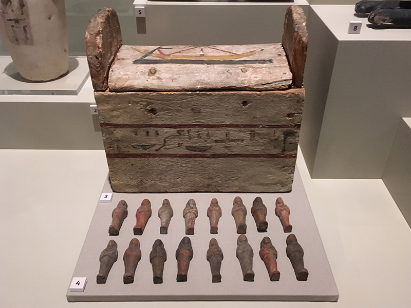A group of shabti's and their box, from a lter burial in the tomb